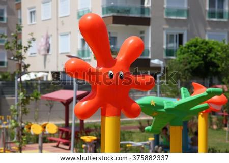 Funny orange blot on the playground in the sun - stock photo