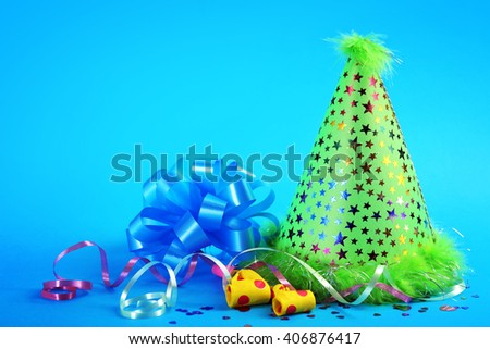 Funny party hat on blue background - stock photo