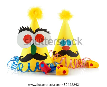 Funny party hats with blowers on a white background - stock photo