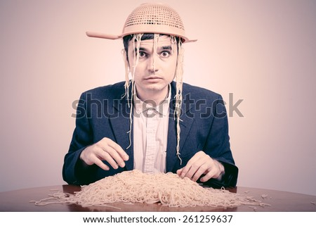Funny Pastafarian with colander and pasta. - stock photo
