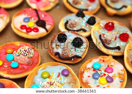 Funny pastry with faces for kids (birthday party) - stock photo