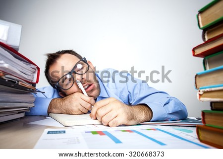Funny photo of businessman with beard wearing shirt and glasses. Overworked businessman sleeping at table full of documents with pen in his nose. Isolated on white background - stock photo