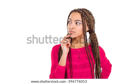 Funny picture of african young woman. Girl with African braids looking aside. Isolated background - stock photo