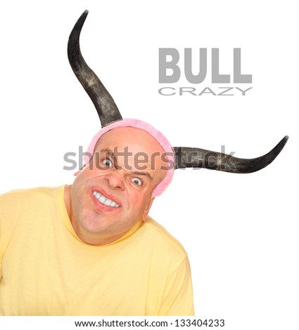 Funny picture of an powerful young man with bulls horns. Picture with space for your text. - stock photo