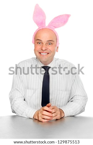 Funny picture of an successful manager with rabbit ears. Happy easter for your company. - stock photo
