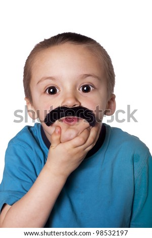 Funny picture of litle boy with huge eyes and a fake mustache. - stock photo