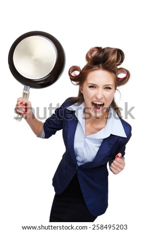 Funny picture of young business woman with curler. Woman screaming at camera and holding pan. Isolated on white background - stock photo