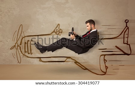 Funny pilot driving a hand drawn airplane on the wall concept - stock photo