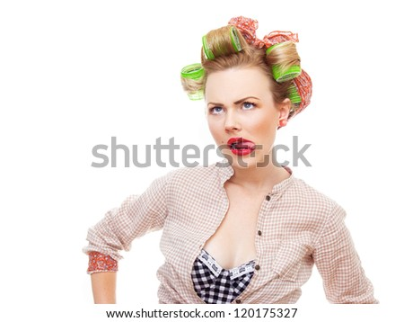 Funny pin-up girl looking up, isolated on light blue background in studio. Old / retro fashion style photo - stock photo