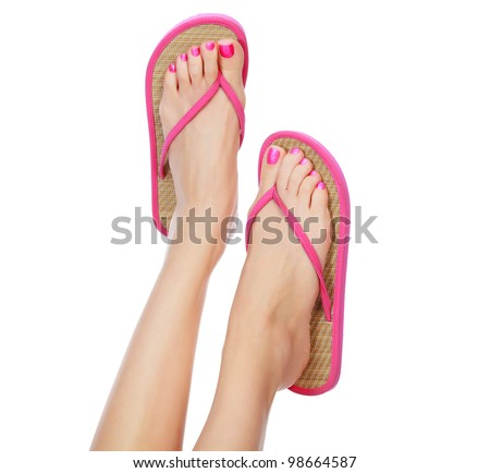 Funny pink sandals on female feet. Isolated on white background. - stock photo
