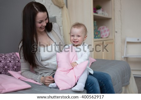 Funny playful mum with baby toddler at home, Funny baby with mother lifestyle - stock photo