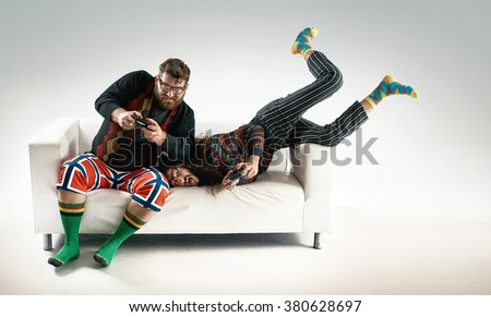 Funny portrait of two best friends playing console - stock photo