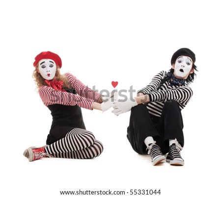 funny portrait of two mimes with red heart. isolated on white background - stock photo
