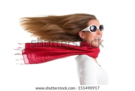 Funny portrait of young woman with flowing hair - stock photo