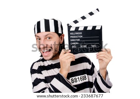 Funny prison inmate with movie board isolated on white - stock photo