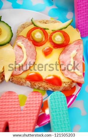 funny sandwich with owl made from cheese,sausage and vegetables for child - stock photo