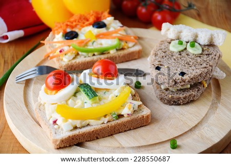 Funny sandwiches with animal faces for kids. Healthy colorful breakfast! - stock photo