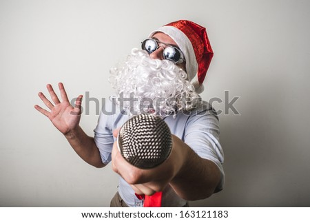 funny santa claus babbo natale singing on white background - stock photo