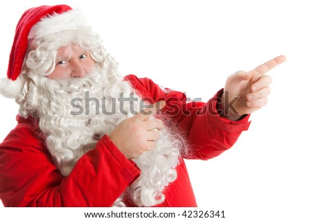 funny Santa Claus showing in right direction with two fingers - stock photo