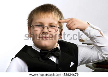 Funny school boy thinking. Isolated over white - stock photo