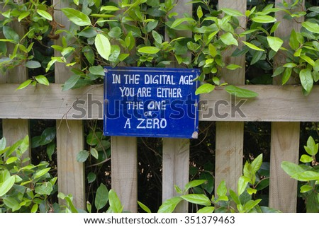 funny sign in the digital age you are either a one or a zero - stock photo