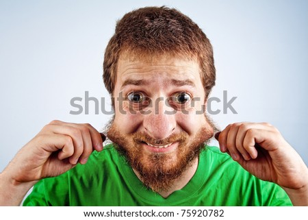 Funny silly man with hairy face - stock photo