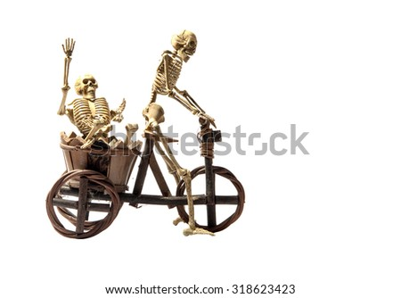 Funny skeleton driving pillion - stock photo