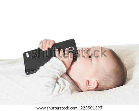 Funny small baby boy holding smartphone isolated - stock photo