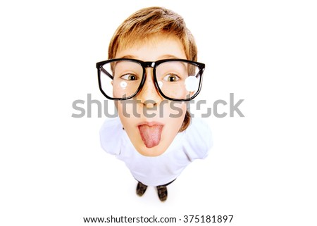 Funny smart boy wearing big glasses. Education. Optics. Studio shot. Isolated over white. - stock photo