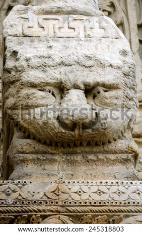 Funny smiling Lion at the facade of the church of St. Trophime in Arles. (Provence, France) - stock photo
