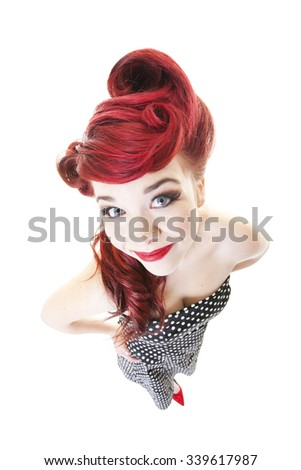 Funny, smiling, red-headed pinup girl.  Shot on white background. - stock photo