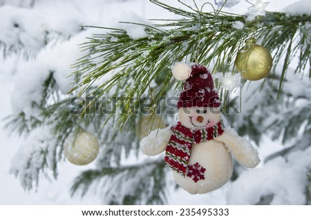 Funny snowman and snowfall - stock photo