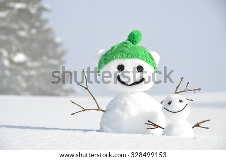Funny snowmen against Swiss Alps - stock photo
