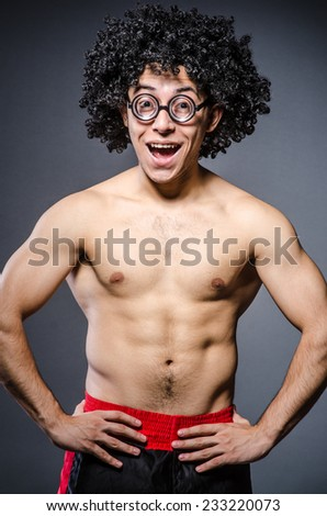 Funny sportsman sporting his muscles - stock photo