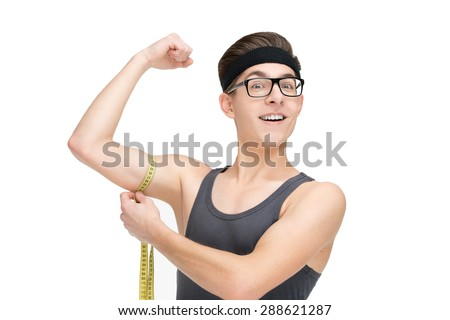 Funny sporty nerd in glasses and measuring tape isolated on white background - stock photo