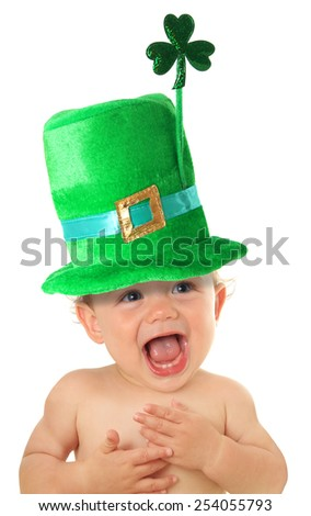 Funny St Patricks day baby wearing a green hat with a shamrock.  - stock photo