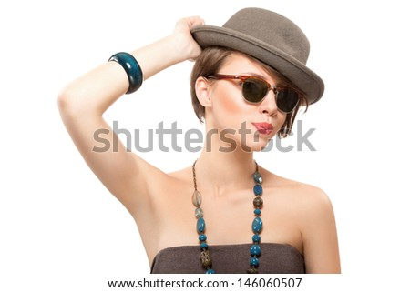 Funny summer portrait of beautiful girl in sunglasses, holding her hat with hand, isolated - stock photo