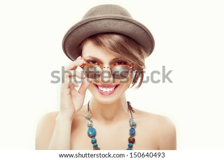 Funny summer portrait of beautiful smiling girl in sunglasses and hat, looking at camera - stock photo