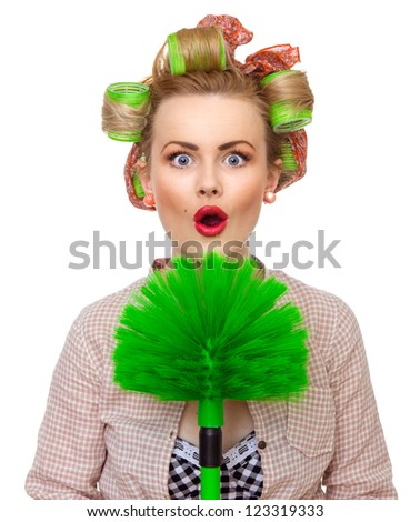 Funny surprised housewife / girl with broom, isolated on white. Close up domestic woman - stock photo