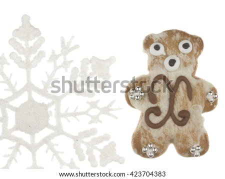 funny sweet tasty gingerbread cute teddy bear pattern and decorated with silver sugar balls and snowflakes on a white background isolated - stock photo