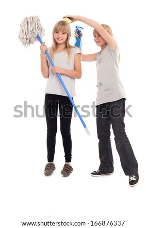 Funny teen girls playing with cleaning utensils - stock photo