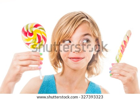 Funny teen with colored nails holding Colorful lollipop. Isolated on white background - stock photo