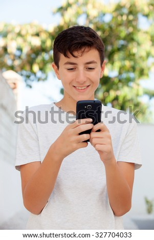 Funny teenage boy looking at the mobile - stock photo