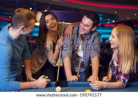 Funny time with friends in billiard club  - stock photo