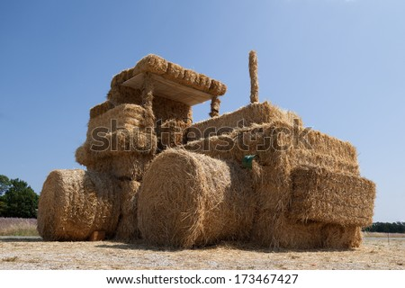 Funny tractor from straw - stock photo