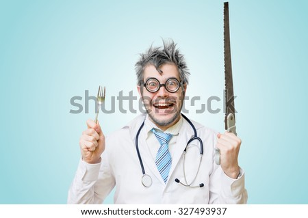 Funny wacky and crazy surgeon doctor holds unusual surgical instruments. - stock photo
