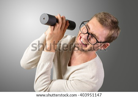 Funny weak man tries to lift a weight - stock photo