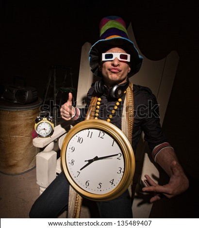 Funny white rapper with multi colored hat and large clock - stock photo