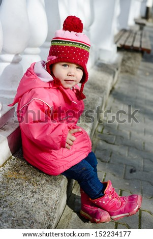 funny winter toddler girl point with finger - stock photo