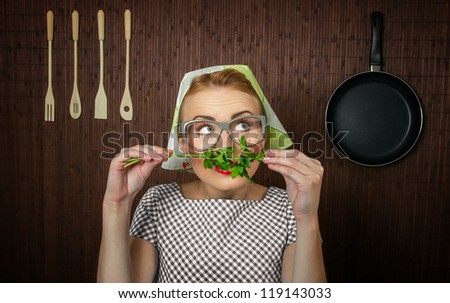 Funny woman cook with parsley - close up - stock photo